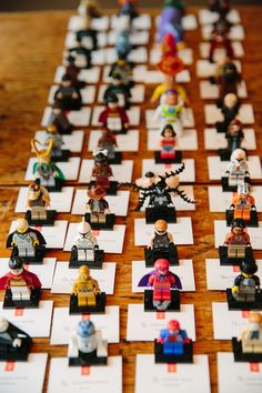 Do something out of the ordinary and bring a little bit of your personality and interests out in your Escort Cards. Love these lego guys!