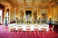 A decorated dining table laid with silver gilt from the George IV Grand service, in the State dining room. The Grand Service is still used today at state banquets by the Queen and her guests