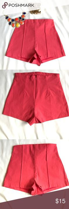"""Charlotte Russe High-Waist Shorts Coral color high-waist shorts. Worn a couple times, 75% Raylon 21% Nylon 4% Spandex. Approx 10"""" length. Zips up in back. The size tag is coming off (see pic) other than that Shorts are in good condition. Please ask any questions. Thank you. Charlotte Russe Shorts"""