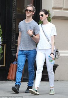 Anne Hathaway goes hand-in-hand with husband Adam Shulman on NYC walk #dailymail