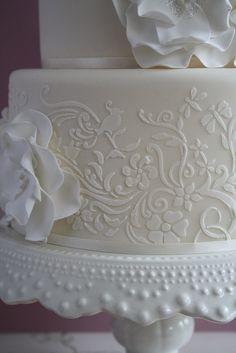 Stenciled white wedding cake