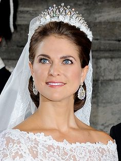 Princess Madeleine of Sweden wore the Modern Fringe tiara instead of the family's traditional wedding topper, the Cameo. Its multiple peaks are dotted with round diamonds and it's said to have been an anniversary present to Queen Silvia from her husband. Royal Wedding Themes, Royal Wedding Gowns, Wedding Tiaras, Royal Weddings, Princess Wedding, Wedding Dresses, Royal Crowns, Royal Tiaras, Royal Jewels
