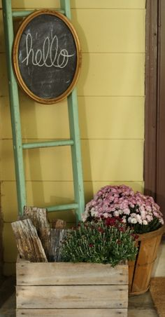Blogger Stylin Home Tour Fall porch entry with hello chalkboard, ladder, mums, logs in crate