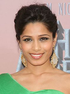 Follow Freida Pinto's lead and swap out the smoky eye standby, basic gray shadow, for standout jewel tones, like L'Oreal HIP Studio Secret Professional Crystal Shadow Duo in Mystical. Rim with thick black liner for added drama.