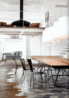 The floor, the lights, the table, the chairs, the perforated room divider...holy hell! Vosgesparis: An industrial white home - Designed by Paola Navone