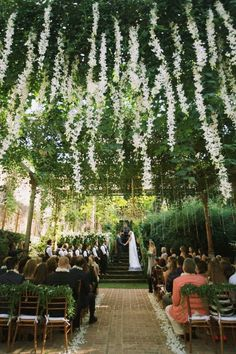 Gorgeous greenery and flowers hung from the ceiling at this dreamy ceremony | Anna Kim Photography