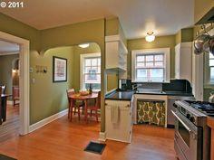 dark countertops, white cupboards, and a breakfast nook (via RMLS listing)