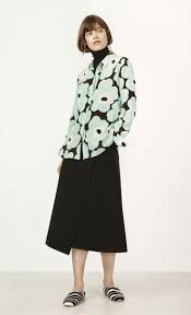 A silk blouse in the iconic Unikko print. It has a hidden front button closure except for the top visible button and button cuffs. The straight cut falls to a hip hemline that's slightly curved and longer in the back. Marimekko, Straight Cut, My Wardrobe, Shirt Outfit, Fashion Bags, Hemline, Street Style, Blouse, Coat