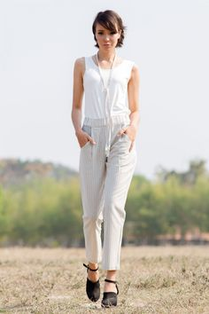 Enjoy the soft summer elegance of these light cotton pants. Light and easy, the soft Sanah vertical pants leave you feeling cool and confident in the warmest of weather thanks to their soft elasticated waistband and slimming vertical stripes. Choose light natural shades or bold, beautiful grey for a new wardrobe essential that will never go out of style.