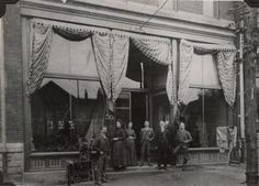 FRANK RAYMOND'S DRY GOODS STORE, northside of Wheeling Avenue, between North 6th and 7th streets.