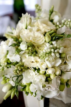Freesia, lilac, lisianthus, tuberose, and sweet pea form the foundation for this fragrant bouquet