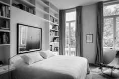 Window Coverings & wall unit around bed. Antwerp apartment inside a building reworked by Vincent Van Duysen