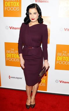 Dita Von Teese looks lovely in a vintage plum dress with Christian Louboutin heels.