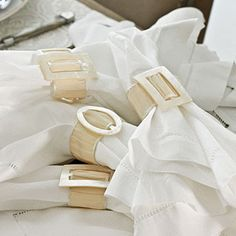 taffeta ribbon looped through old belt buckles make quick, easy and elegant napkin rings.  We will try with beach hues.