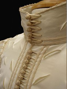 1620s suit of apparel reproduction made by Ninya Mikhaila for Perth Museum and Gallery, Scotland. The doublet is a reconstruction of an original in the museum's collection. The breeches are based on a pair on the Victoria and Albert Museum. The buttons and braid were made by Gina Barrett.