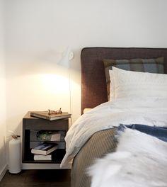 http://decordots.com/wp-content/uploads/2012/10/polstered-IKEA-headboard.-Arne-Jacobsen-lamp..jpg