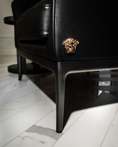 Hints of Medusa can be seen on geometric furniture, supple leather upholstery and glossy metal surfaces. #VersaceHome Versace Home, Versace Fashion, Geometric Furniture, Empire Style, Home Collections, Tiles, Upholstery, Chair, Luxury