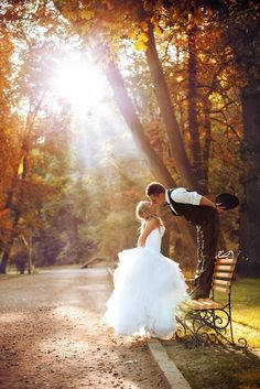 bride and groom kissing fall wedding backdrop // fall outdoor wedding photo