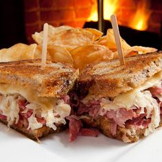 The Reuben sandwich is an American hot sandwich composed of corned beef, Swiss cheese, sauerkraut, and Russian dressing, grilled between slices of rye bread. Reuben Sandwich, Best Sandwich, Russian Dressing, Food Words, Corned Beef, Sandwiches, Food And Drink, Yummy Food, Delicious Dishes