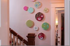 wall art with fabric and embroidery hoops via inspired by charm
