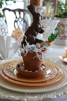 Lovely Easter Table Setting...love the clay pot with the chocolate bunny & candy eggs.