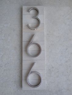 Modern House Numbers Plaque on Sun-Bleached Wood