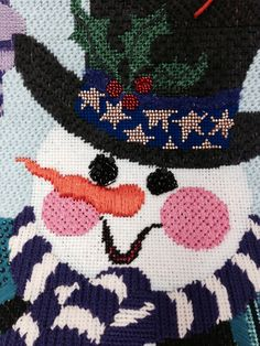 "Eyes are stitched in ""fiesta"" beading.  Meredith Willett, needlepoint snowman"
