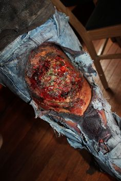 rotten disgusting chopped up zombie leg wound for halloween