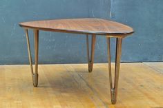 BC Mobler Amoeba Coffee Table Denmark, c.1950s. Vintage Mid-Century Vogue Danish Organic Sculptural Tri-leg Coffee Table. Mahogany Edge Band, Oak Surfaces, Brass Tipped Open Leg Design. Mfg'd by BC Møbler, Unknown Designer.  W: 49 x D: 28 x H: 16.75 in.