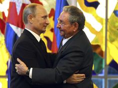 "Cold War: Russia Reopens Spy Base in Cuba. This photo shows Putin hugging the ""President"" of Cuba Raul Castro, as if they were long lost lovers who are finally ""reunited and it feels so good""."