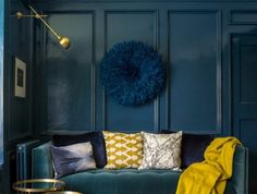 The combination of moody blue walls and brass accessories, makes this room a winner. But do you know what the 1 key thing is that's making this home really pop? Blue Couch Living Room, Home Living Room, Living Room Decor, Teal Living Rooms, Apartment Living, Room Color Schemes, Room Colors, Casa Milano, Teal Rooms