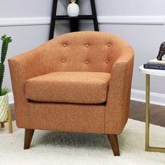 Brayden Studio This classic barrel chair has a mid-century modern twist that makes this a great addition to almost any room. This product is made with quality, comfort and modern style in mind.