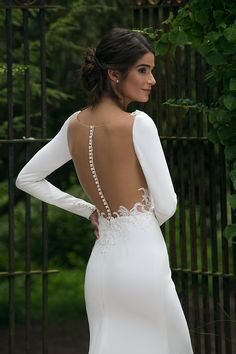 Sincerity Bridal Style 44045 - Illusion back wedding dress with button details.  Crepe fit and flare wedding dress with long sleeves.