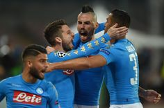 Napoli's forward from Belgium Dries Mertens (L) celebrates with teammates Napoli's defender from Algeria Faouzi Ghoulam (R) and Napoli's midfielder from Slovakia Marek Hamsik (C) after scoring during the UEFA Champions League football match SSC Napoli vs Real Madrid on March 7, 2017 at the San Paolo stadium in Naples. / AFP PHOTO / Filippo MONTEFORTE