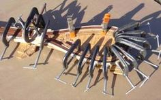 Pictures of clamps and forms used to glue fly fishing landing net frames.