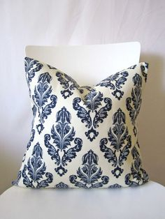 18 inch throw pillow cover, floral navy blue crest on cream color. Geometric, classic and traditional print. For indoor or outdoor use.