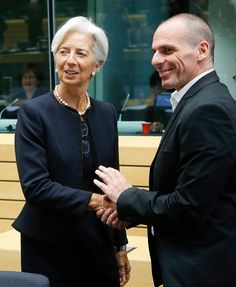 epa04818003 International Monetary Fund (IMF) managing director Christine Lagarde and Greek Finance Minister Yanis Varoufakis (R) at the start of a special Eurogroup Finance ministers meeting on Greek crisis at EU council headquarters in Brussels, Belgium, 25 June 2015.