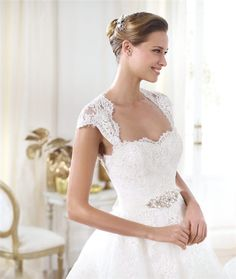af - sweetheart neckline, cute cap sleeves, A-line silhouette, lace. YES, OBSESSED, A PLUS.