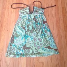 Green halter top sun dress with padding Beautiful green colored dress. Perfect for the summer. Padding on chest. Halter top with a tie. Rouging on outer chest. Originally bought at Macy's. Lining all the way through. Sheer top. Stretchy design. A great piece to have for the summer! Dresses Mini
