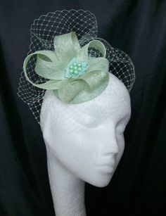 Pale Surf Green Blusher Veil & Sinamay Fascinator Mini Cocktail Hat. Visit www.indigodaisyweddings.co.uk for all your wedding, Royal Ascot, Kentucky Derby fascinator mini and formal hats, shoe clips, vintage flapper bands, feather and flower fascinators, feather fans fairy wands, wrist corsages, wedding bouquets & buttonholes. Beautiful, unique and handmade.