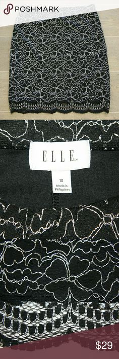 Elle Skirt sz 10 Great condition! Elle Skirt.  Sz 10. Black lace overlay cotton knit. Elastic waistband.  If you have only one skirt in your closet --  this is The One.  Versatile! Work. Around town. Special event. Sunday morning. Dinner. Lunch meeting. Date night. Office. Brunch. Travel.  Does not wrinkle. Dress up or casual. Super comfortable.  Timeless silhouette. Elle Skirts Pencil