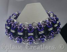 Rondo weave in lilac, lavender, black, silver and purple anondized aluminum. #chainmailjewelry #chainmaillejewelry #chainmaille…