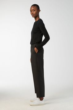 These wool blend trousers bear the distinct diagonal stripes, significant for the cavalry twill. A high-waist style with slightly carrot shaped legs and cr