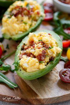 Cheesy Scrambled Eggs in Avocado With Crispy Bacon Pieces | http://cafedelites.com