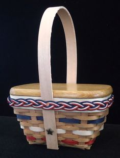 """2018 Miniature Patriotic Picnic Basket!  Sports a unique outside handle with star accents and beautiful braid trim!  Measures 3.5"""" x 2.25"""" x 4.5"""".  Measurements include handle and may vary slightly.  Comes with solid Birch lid  $32.99 Beautiful Braids, Birch, Baskets, Picnic, Miniatures, Handle, Star, Unique, Sports"""