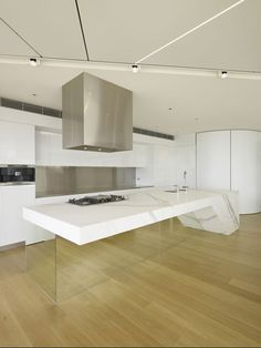 I strongly suspect this Australian penthouse, seen on Architizer, was not a DIY project, but the idea is transferable to humbler homes. This kitchen island, outfitted with a mirrored base, is endlessly glam. If you don't have an island, you could add mirrors to cabinet faces, or your backsplash.