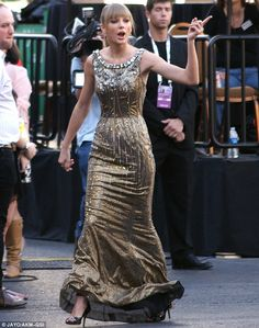 Going for gold: The singer showed off her slender figure as she arrived at the awards show