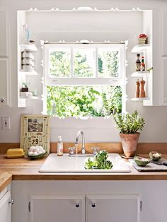 The scrollwork that frames this kitchen window is original to the 1850s farmhouse.