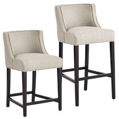 Eva is like a warm hug from your best-dressed friend. Upholstered to the nines in a flax-colored, tweed-like polyester, our contemporary stools have curves in all the right places. Contoured backs and deep seats provide uncommon comfort; self-welted fabric and smooth espresso legs add sophistication and style.  $259.95