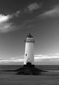 Lighthouse on Talacre Beach, North Wales The 'Point of Ayr' lighthouse has stood on Talacre Beach in Wales in various incarnations since 1776, watching over ships make the trek across Liverpool Bay from the Welsh town of Lllandudno. Abandoned since 1840.